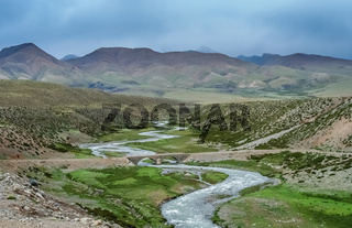 Mountain road through the valley in Tibet