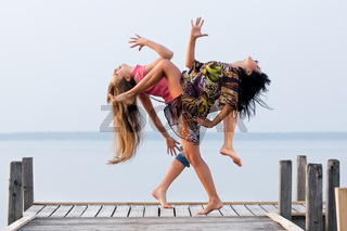 two girl  are dancing