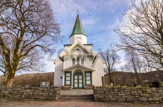 White church and blue sky with small clouds in Norway