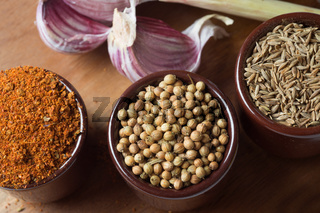 Spices and herbs in ceramic bowls. Food and cuisine ingredients. Colorful natural additives.