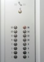 Elevator metal control panel with round buttons with numbers of floors