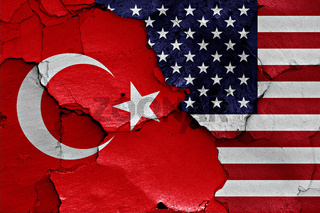 flags of Turkey and USA painted on cracked wall