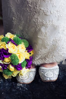 Shoes, bride, wedding dress and bridal bouquet