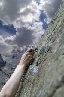 Climbers hand with quick-draws