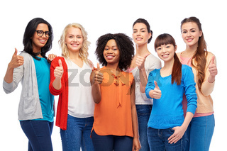 international group of women showing thumbs up