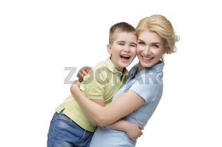 Young mother hugging son