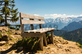 Empty wooden bench in the bavarian alps