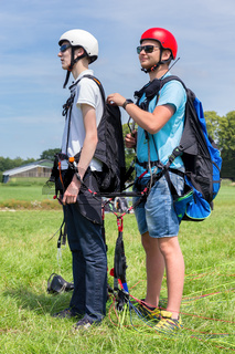 Paragliding instructor with boy  for tandem flight