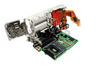 Digital camera in a disassembled form. Close-up. Isolated on a white background.