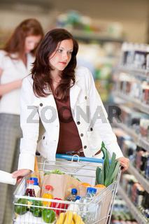 Shopping series - Beautiful brunette in cosmetics department