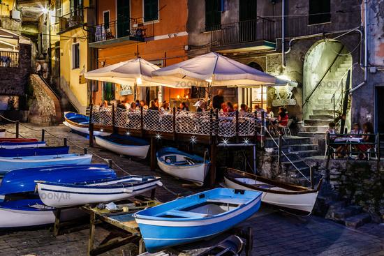 Illuminated Street of Riomaggiore in Cinque Terre at Night, Italy