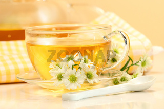 Glass tea cup with herbal tea