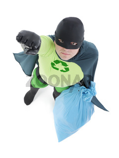 Eco superhero holding blue plastic bag full of domestic trash pointing his hand up standing on white background - waste segregation concept