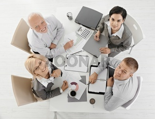 Smiling businesspeople at meeting