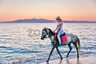 Young woman riding a horse