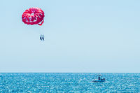 Parasailing summer experience in Albufeira, Portugal.