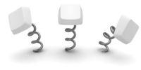 Three blank computer keys on springs