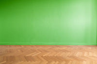 green wall background in empty room with parquet floor