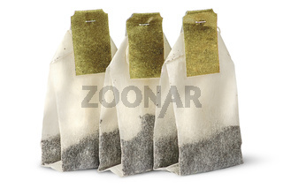 Three tea bags with labels
