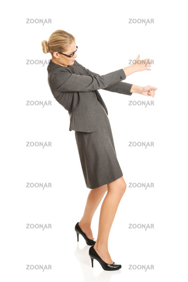 Businesswoman pulling a stick