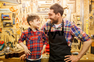 happy father and little son workshop