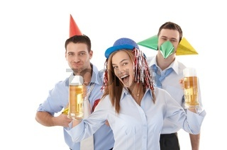 Young people having party in office laughing
