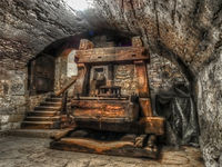 Old antique wooden press in a vaulted cellar