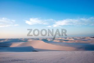 Lencois Maranhenses National Park, Barreirinhas, Brazil, low, flat, flooded land, overlaid with large, discrete sand dunes with blue and green lagoons