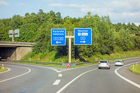 freeway road sign on Autobahn A81, Karlsruhe / Heilbronn - exit Munich / Airport / Mess