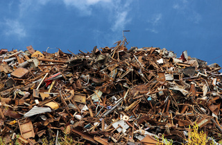 pile of scrap black metal piled in the open air