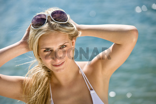 Blond beautiful woman enjoy summer sun