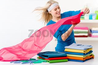 Laundry - woman folding clothes