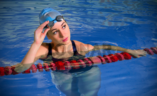 Young woman swimmer in pool