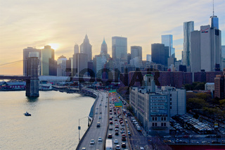 View from the Manhattan Bridge towards the Brooklyn Bridge across the Two Bridges waterfront in the evening in New York