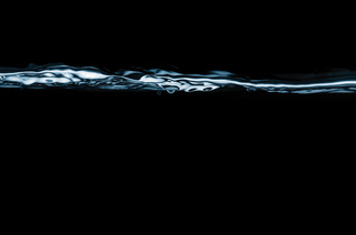 closeup of water waves isolated on black