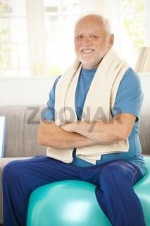 Active senior sitting on fit ball