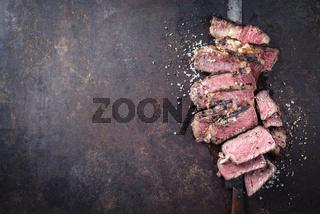Barbecue Entrecote Steak sliced on old metal Sheet