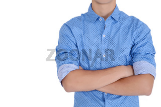 Attractive young man with his arms crossed