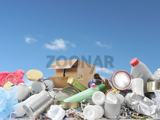 Heap of assorted domestic garbage over blue sky