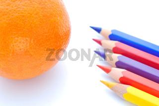colored pencils with orange