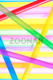 Colorful drinking straws close up abstract background