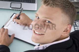 back pose of smiling lawyer with pen and writing board