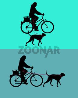 Radfahrerinnen mit Hunden an der Leine