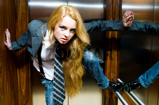 Young woman in lift