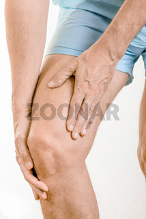 Athlete man feeling pain to the quadriceps and to the knee