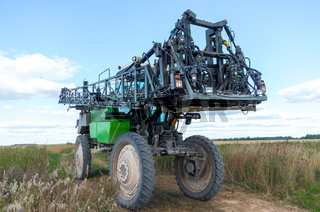 Self propelled sprayer in a Lithuanian field.