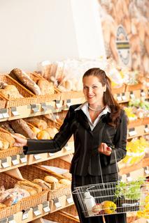 Grocery store: Business woman choosing bread