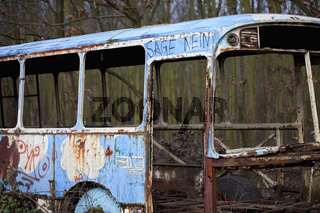 say no, written on a bus wreck