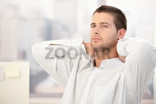 Young man thinking in office