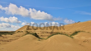 Summer clouds over the Rubjerg Knude. High sand dune at the west coast of Denmark.